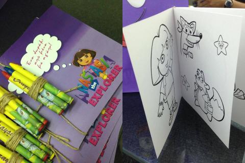 Dora the Explorer birthday party invitations map customized tags happy face handmade backpack favors gifts presents friends guests fun purple paper squirt gun water drawing book sketch crayons colours coloring lollipop ribbon plastic bag playdoh content