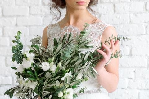 eucalyptous flower floral wedding bouquet girl holding bride dress gown white olive branch beautiful greenery trends