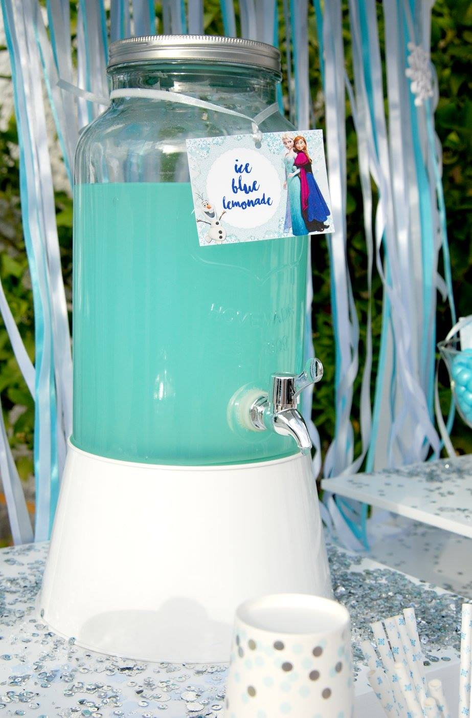 Frozen Elsa Anna party ice blue lemonade glass jar dispencer candy bar ribbons sparkle yard garden