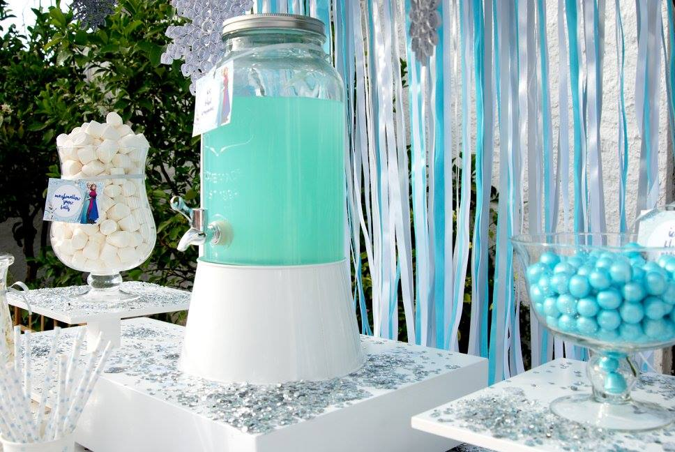Frozen Elsa Anna party ice blue lemonade glass jar dispencer candy bar ribbons sparkle yard garden pop corn tags pearls candy