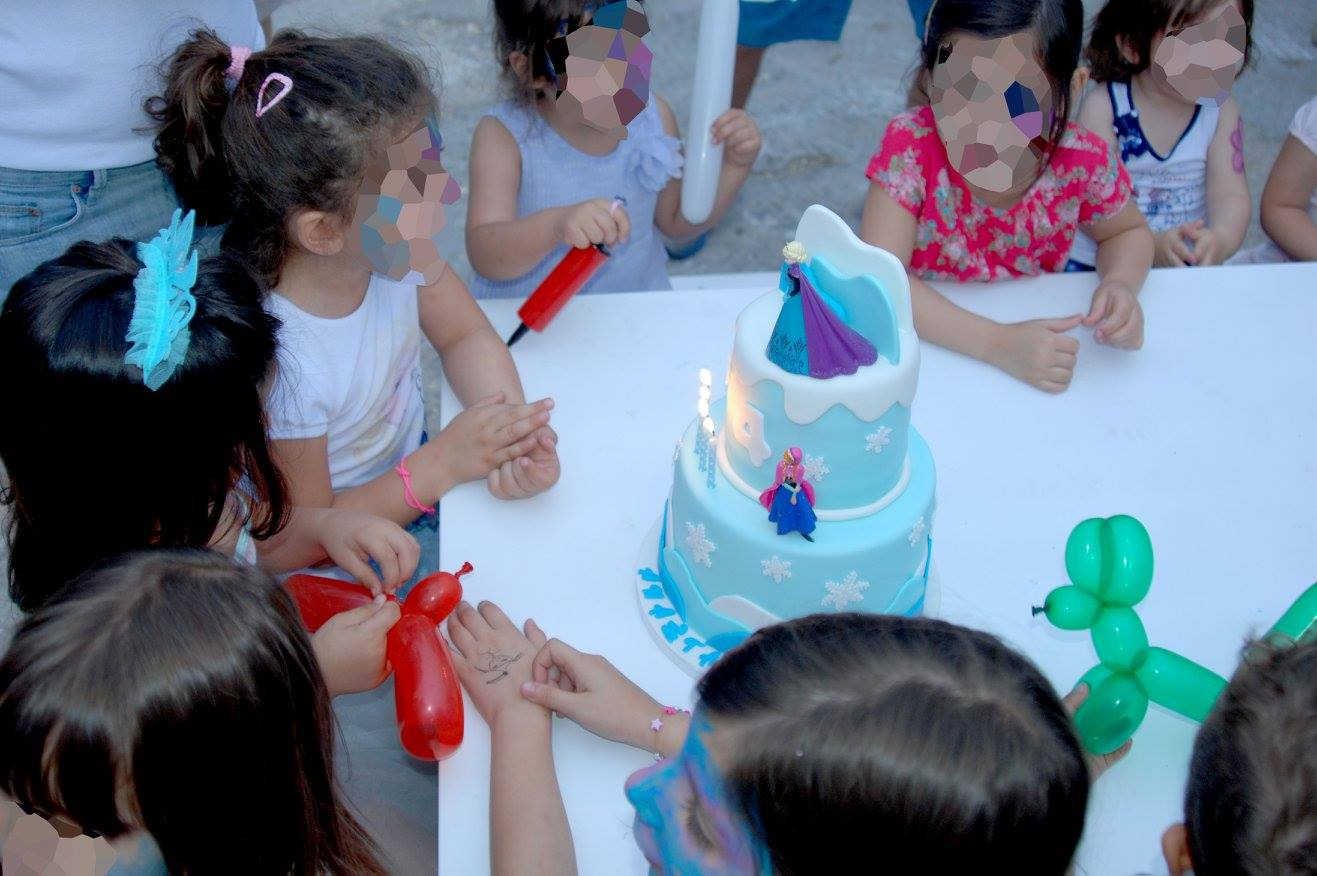 Frozen Elsa Anna party yard garden princess cake blow out candles friends quests table face painting